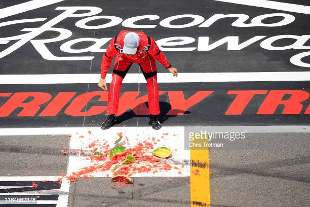 Ross Chastain driver of the Niece/Acurlite Chevrolet celebrates by smashing a watermelon following his victory in the NASCAR Gander Outdoors Truck...