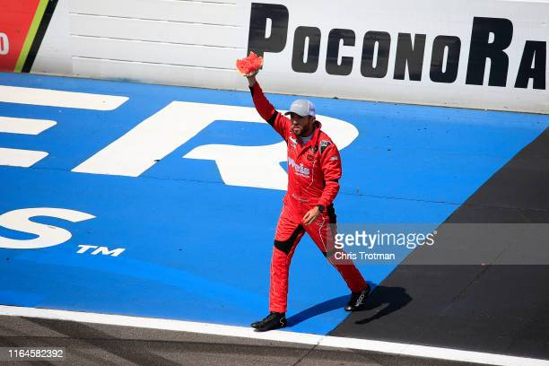 Ross Chastain driver of the Niece/Acurlite Chevrolet celebrates by eating a watermelon following his victory in the NASCAR Gander Outdoors Truck...