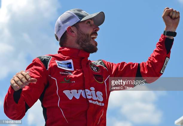 Ross Chastain driver of the Niece/Acurlite Chevrolet celebrates in Victory Lane after winning the NASCAR Gander Outdoors Truck Series Gander RV 150...