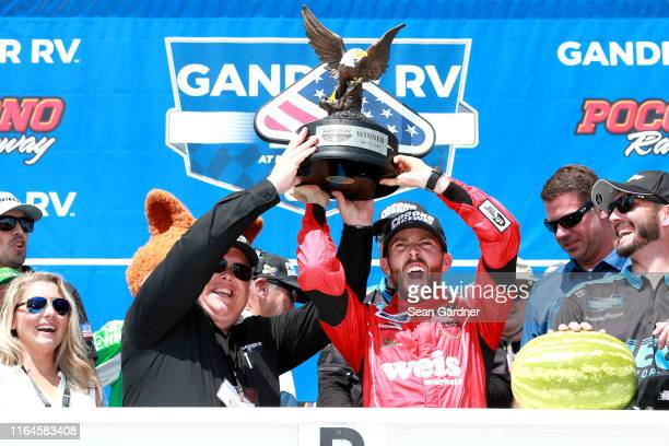 Ross Chastain driver of the Niece/Acurlite Chevrolet celebrates with his team in Victory Lane after winning the NASCAR Gander Outdoors Truck Series...