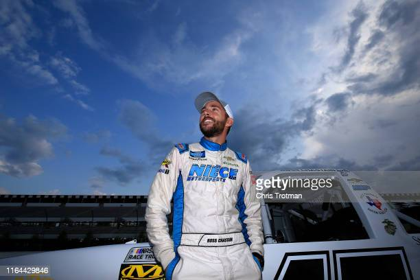 Ross Chastain driver of the Niece/Acurlite Chevrolet stands on the grid during qualifying for the NASCAR Gander Outdoors Truck Series Gander RV 150...