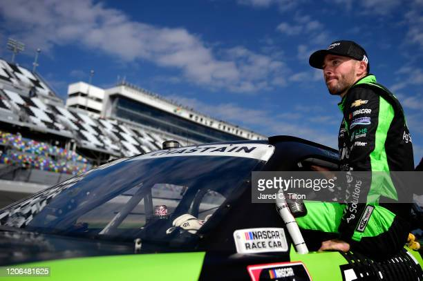 Ross Chastain driver of the Nutrien Ag Solutions Chevrolet climbs into his car during qualifying for the NASCAR Xfinity Series NASCAR Racing...