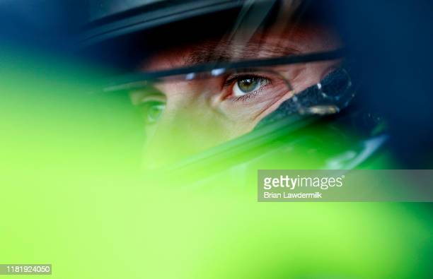 Ross Chastain driver of the Nutrien Ag Solutions Chevrolet sits in his car during practice for the NASCAR Xfinity Series Kansas Lottery 300 at Kansas...