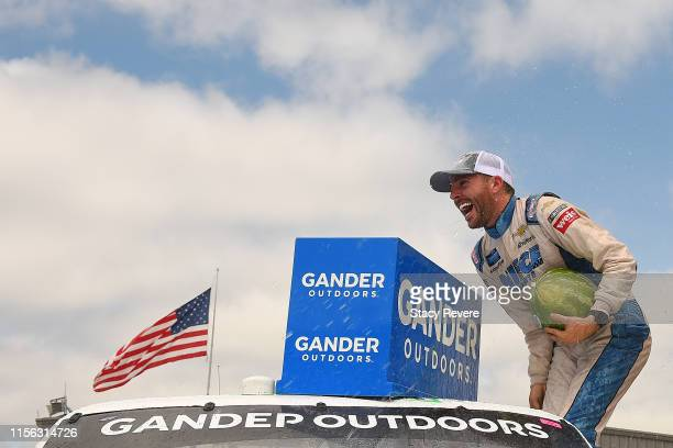 Ross Chastain driver of the TruNorth/Paul Jr Designs Chevrolet celebrates in Victory Lane after winning the NASCAR Gander Truck Series MM's 200...