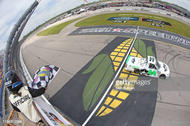 Ross Chastain driver of the TruNorth/Paul Jr Designs Chevrolet takes the checkered flag to win the NASCAR Gander Outdoor Truck Series MM's 200...