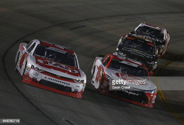 Ross Chastain driver of the USVets911com Chevrolet and Christopher Bell driver of the Rheem Toyota lead a pack of cars during the NASCAR Xfinity...