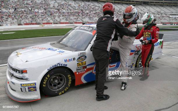 Ross Chastain waits to replace Wendell Chavous driver of the SobrietyNationorg Chevrolet as he exits his truck after falling ill during the NASCAR...