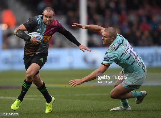 Ross Chisholm of Harlequins gets past Chris Harris of Gloucester to score his team's first try during the Gallagher Premiership Rugby match between...