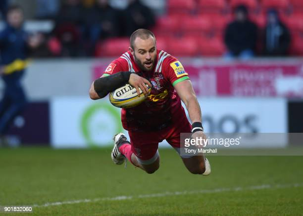 Ross Chisholm of Harlequins scores a try during the Aviva Premiership match between Sale Sharks and Harlequins at AJ Bell Stadium on January 6, 2018...