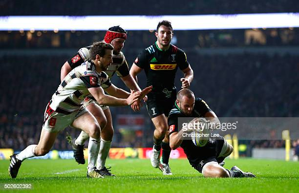 Ross Chisholm of Harlequins scores his teams fifth try during the Aviva Premiership 'Big Game 8' match between Harlequins and Gloucester at...