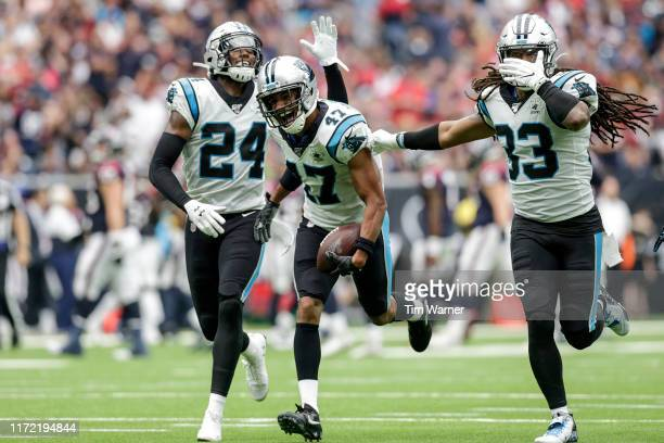 Ross Cockrell of the Carolina Panthers celebrates with teammates after an interception in the second quarter against the Houston Texans at NRG...