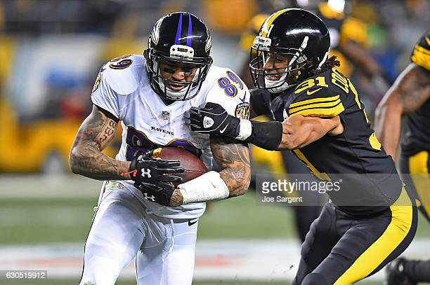 Ross Cockrell of the Pittsburgh Steelers attempts to wrap up Steve Smith of the Baltimore Ravens for a tackle in the first half during the game at...