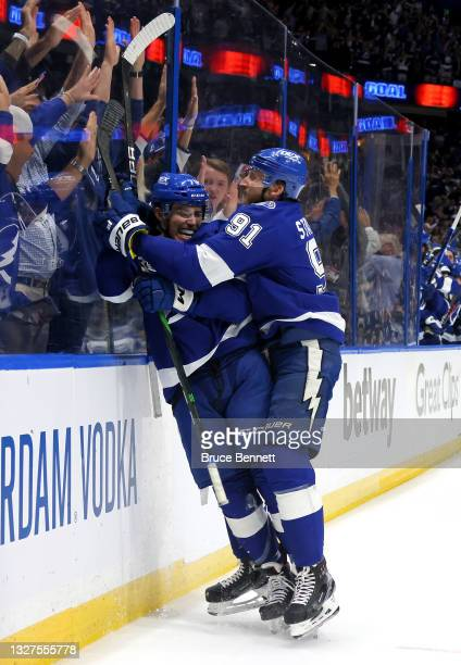 Ross Colton of the Tampa Bay Lightning celebrates with Steven Stamkos after scoring against Carey Price of the Montreal Canadiens during the second...