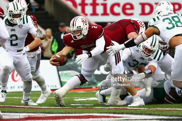Ross Comis of the Massachusetts Minutemen scores a touchdown during the first quarter against the Ohio Bobcats at Warren McGuirk Alumni Stadium on...