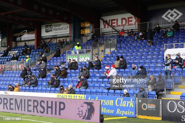 Ross County fans are seen wearing santa hats socially distanced in the stands prior to the Ladbrokes Scottish Premiership match between Ross County...