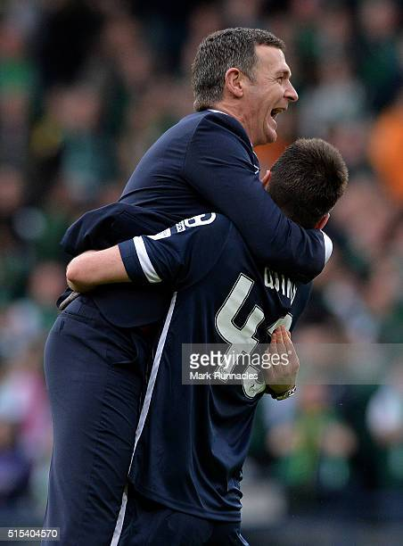Ross County manager Jim McIntyre is congratulated by Paul Quinn as Ross County beet Hibernian 2-1 during the Scottish League Cup Final between...