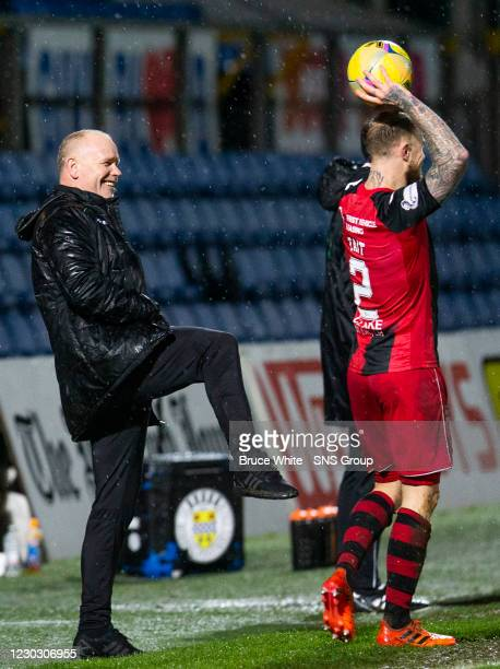 Ross County manager John Hughes has a joke with St Mirren's Richard Tait during the Scottish Premiership match between Ross County and St Mirren and...