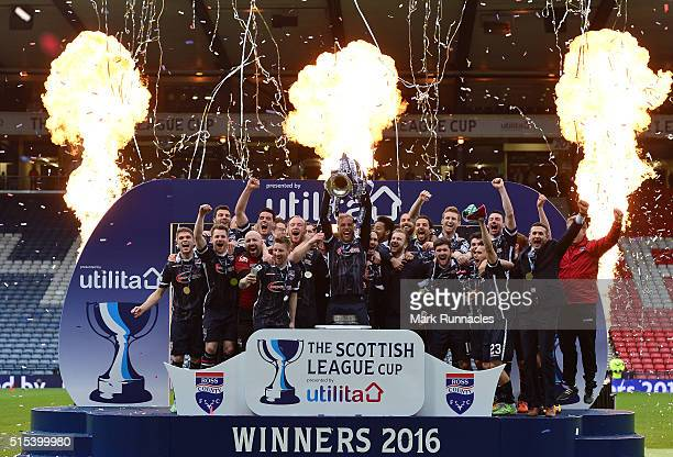 Ross County players and coaching staff celebrate with the League Cup Trophy as Ross County beat Hibernian 21 during the Scottish League Cup Final...