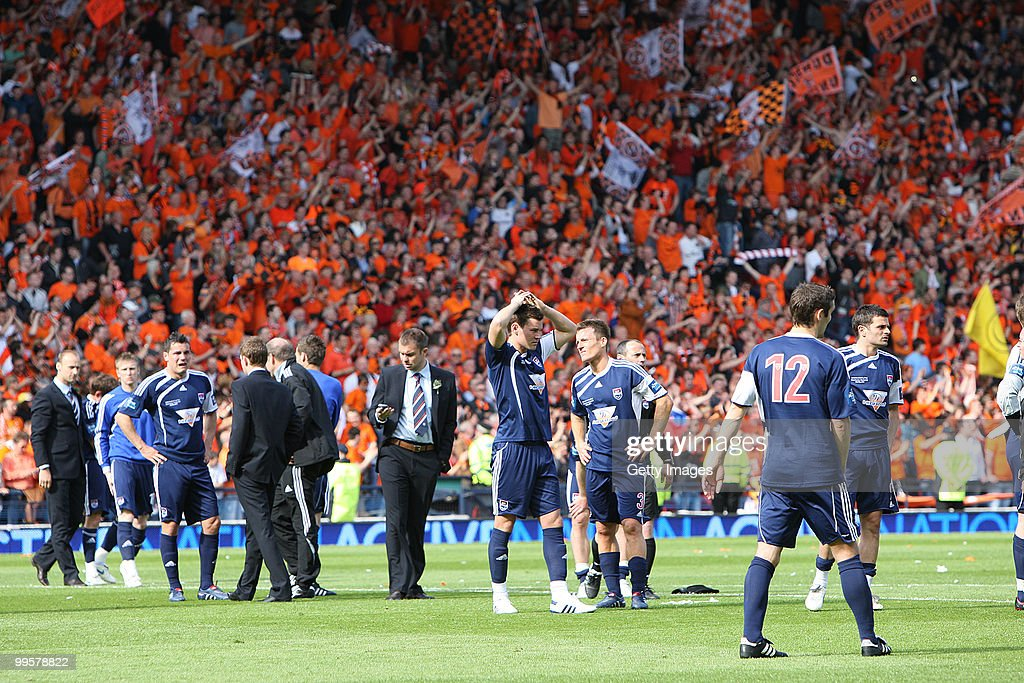 Ross County players look dejected after the Active Nation Scottish FA Cup Final between Dundee United and Ross County at Hampden Stadium on May 15, 2010 in Glasgow, Scotland.