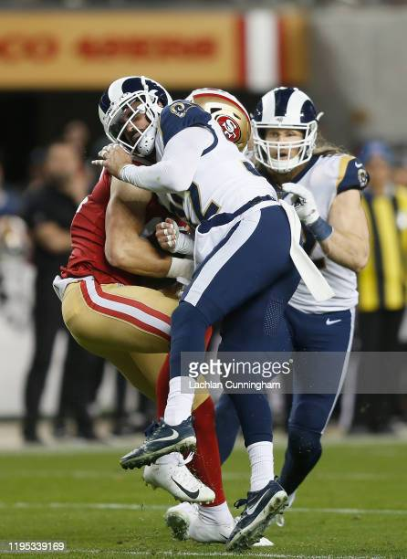 Ross Dwelley of the San Francisco 49ers makes a catch against Eric Weddle of the Los Angeles Rams in the fourth quarter at Levi's Stadium on December...