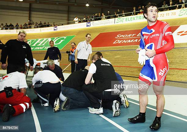 Ross Edgar of Great Britain looks on as Chris Hoy lies on the track receiving medical attention after they both crashed out of the final of the...