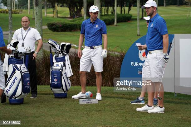 Ross Fisher and Bernd Wiesberger of tean Europe waits on the 2nd hole during the official practice ahead of the EurAsia Cup presented by DRBHICOM at...