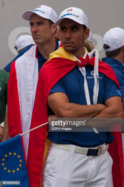 Ross fisher and Rafa Cabrera Bello seen wearing their own country flag and their back after the EurAsia match had ended EurAsia Cup is a biennial men...