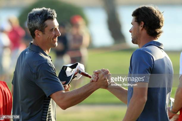 Ross Fisher of England and Thomas Pieters of Belgium shake hands on the 18th green after finishing during round three of the Abu Dhabi HSBC Golf...