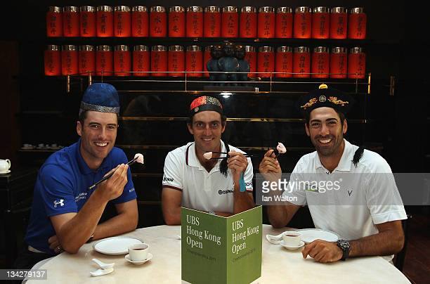 Ross Fisher of England Edoardo Molinari of Italy and Alvaro Quiros of Spain pose for photos at Hullet House during previews ahead of the USB Hong...