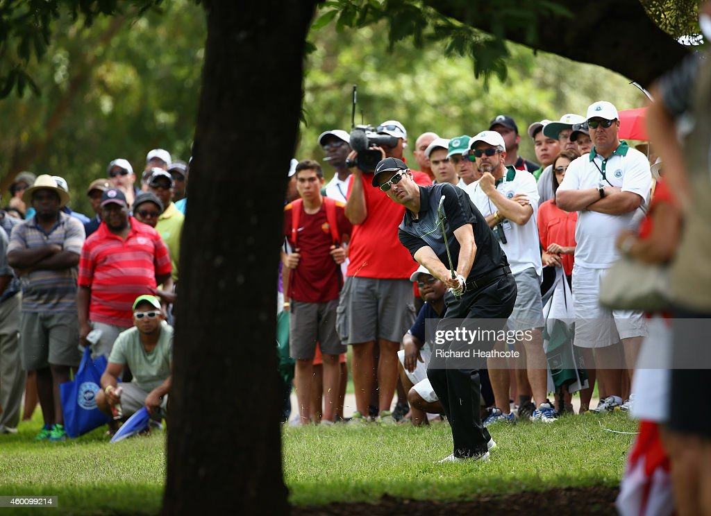 Ross Fisher of England in action during the final round of the Nedbank Golf Challenge at the Gary Player Country Club on December 7, 2014 in Sun City, South Africa.