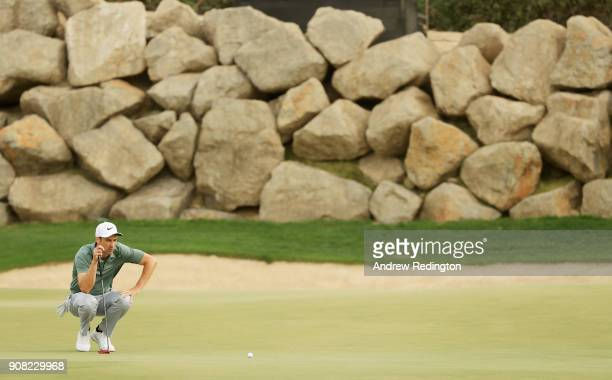 Ross Fisher of England lines up a putt on the 12th green during the final round of the Abu Dhabi HSBC Golf Championship at Abu Dhabi Golf Club on...