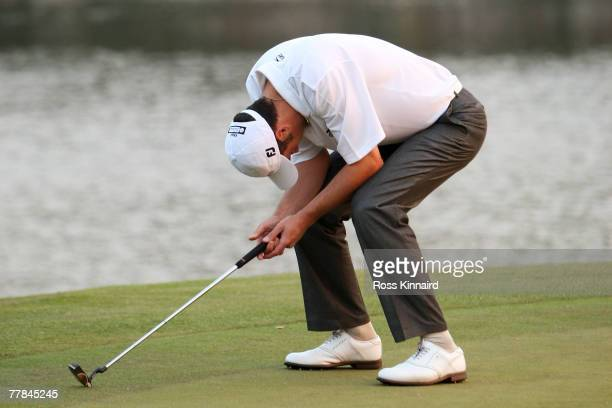 Ross Fisher of England looks dejected on the 18th green during the playoff during the final day of the HSBC Champions at the Sheshan Golf Club on...
