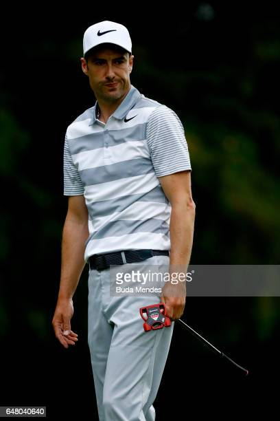 Ross Fisher of England looks on after putting on the 18th hole during the third round of the World Golf Championships Mexico Championship at Club De...