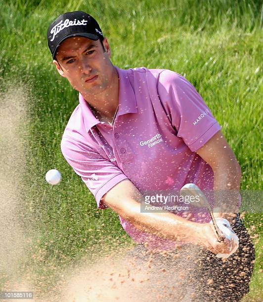 Ross Fisher of England plays a bunker shot on the 17th hole during the first round of the Celtic Manor Wales Open on The Twenty Ten Course at The...
