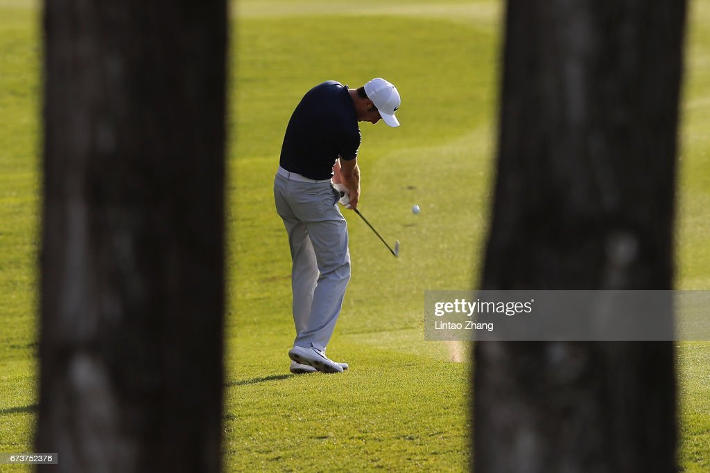 Ross Fisher of England plays a shot during the first round of the 2017 Volvo China open at Topwin Golf and Country Club on April 27, 2017 in Beijing, China.