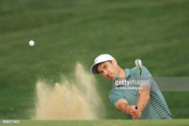 Ross Fisher of England plays his fifth shot from a bunker on the tenth hole during the final round of the Abu Dhabi HSBC Golf Championship at Abu...