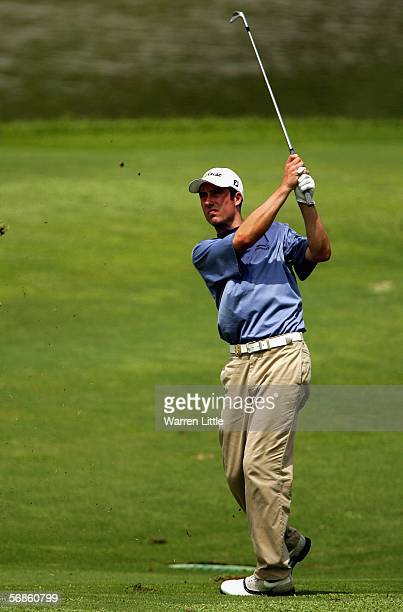 Ross Fisher of England plays his second shot into the ninth green during the first round of the Maybank Malaysian Open 2006 at Kuala Lumpur Golf and...