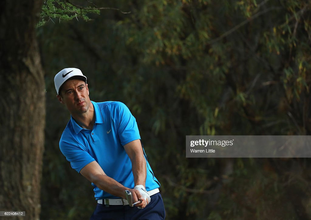 Ross Fisher of England plays his second shot on the 14th hole during the second round of the Nedbank Golf Challenge at the Gary Player CC on November 11, 2016 in Sun City, South Africa.