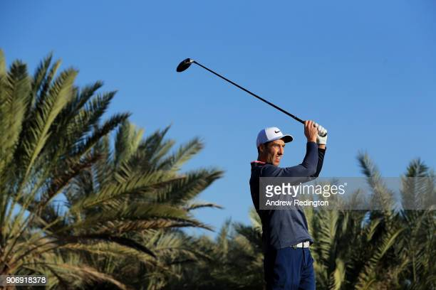 Ross Fisher of England plays his shot from the 14th tee during round two of the Abu Dhabi HSBC Golf Championship at Abu Dhabi Golf Club on January...