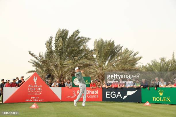 Ross Fisher of England plays his shot from the 14th tee during the final round of the Abu Dhabi HSBC Golf Championship at Abu Dhabi Golf Club on...