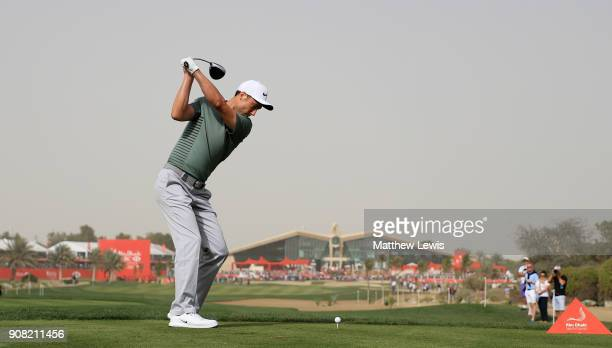 Ross Fisher of England plays his shot from the 18th tee during the final round of the Abu Dhabi HSBC Golf Championship at Abu Dhabi Golf Club on...