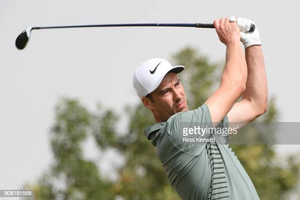 Ross Fisher of England plays his shot from the third tee during the final round of the Abu Dhabi HSBC Golf Championship at Abu Dhabi Golf Club on...