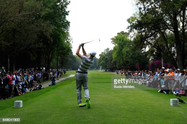 Ross Fisher of England plays his tee shot on the ninth hole during the third round of the World Golf Championships Mexico Championship at Club De...