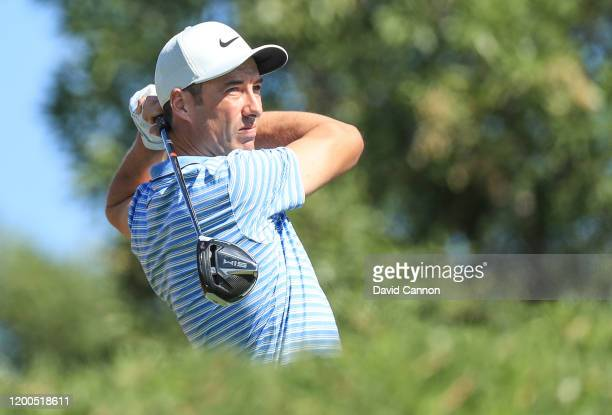 Ross Fisher of England plays his tee shot on the third hole during the final round of the Abu Dhabi HSBC Championship at Abu Dhabi Golf Club on...