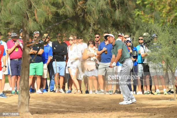 Ross Fisher of England plays his third shot on the tenth hole during the final round of the Abu Dhabi HSBC Golf Championship at Abu Dhabi Golf Club...