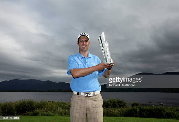 Ross Fisher of England poses with the trophy after victory during the final round of the 3 Irish Open at Killarney Golf and Fishing Club on August 1...