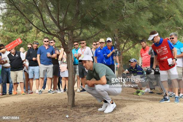 Ross Fisher of England prepares to play his second shot on the tenth hole during the final round of the Abu Dhabi HSBC Golf Championship at Abu Dhabi...