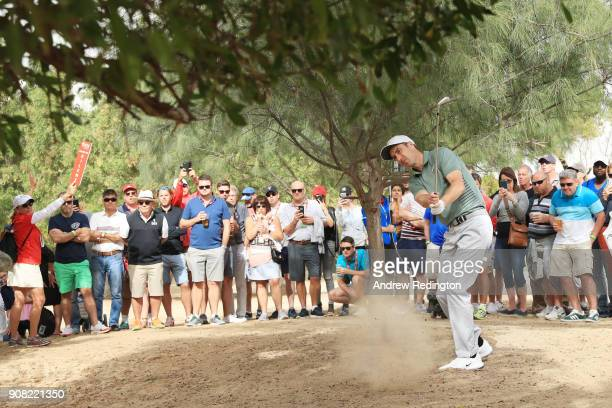 Ross Fisher of England prepares to play his third shot on the tenth hole during the final round of the Abu Dhabi HSBC Golf Championship at Abu Dhabi...