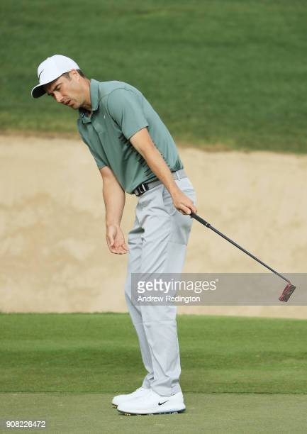 Ross Fisher of England reacts to a missed puutt for birdie on the 11th green during the final round of the Abu Dhabi HSBC Golf Championship at Abu...