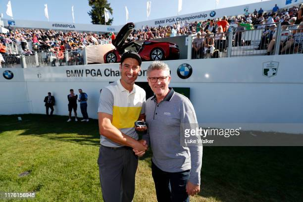 Ross Fisher of England receives the keys to the BMW i8 Roadster, from Graeme Grieve, BMW Chief Executive Officer, following an albatross on the 18th...